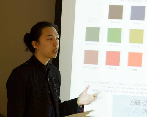 Student talking in front of screen projection of color swatches