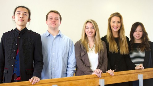 Five students in front of banister.