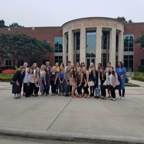 """""""Students outside cotton Incorporated on a field trip."""""""